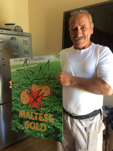Joseph Farrugia holding the poster representing their brand in Holland